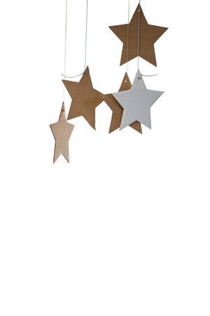 personal ornaments: Close-up of star shape decorations on white background