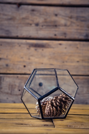 pinecones: Close-up of pine cone in glass container