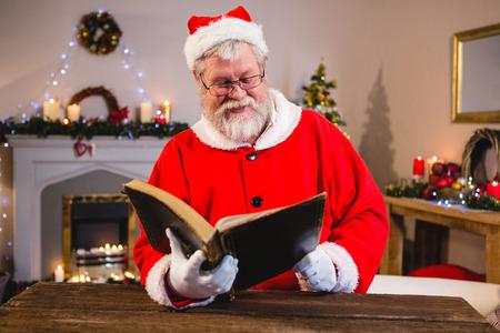 Santa Claus reading book at home
