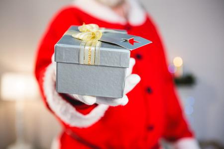 Close-up of santa claus giving a gift