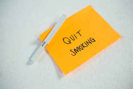 New years resolutions quit smoking with single cigarette on white background