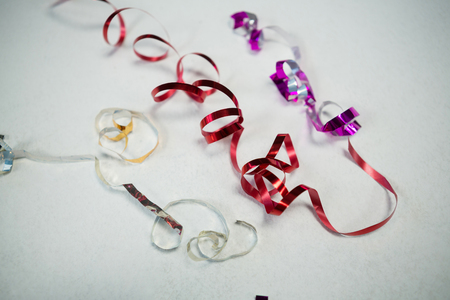 Overhead of colorful ribbons on white background