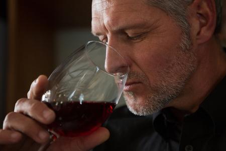 Waiter drinking wine in restaurant