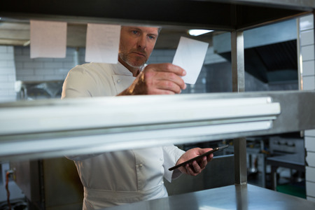 Male chef reading an order in the kitchen