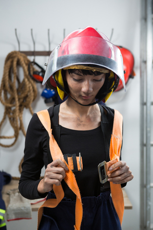 Female architect wearing safety straps in workplace Stock Photo
