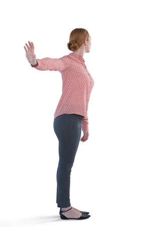 uninterested: Woman making stop gesture against white background