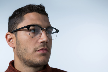 Close-up of man wearing spectacles looking sideways Stock Photo