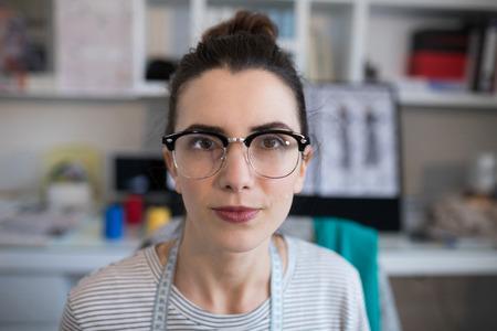 Portrait of female designer wearing spectacles