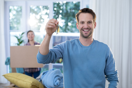 Portrait of smiling man showing a key of their new house Stock Photo