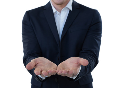 Mid section of businessman pretending to hold an invisible object Stock Photo