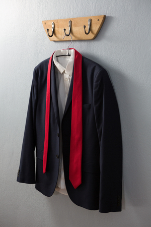 Close-up of blazer hanging on hook