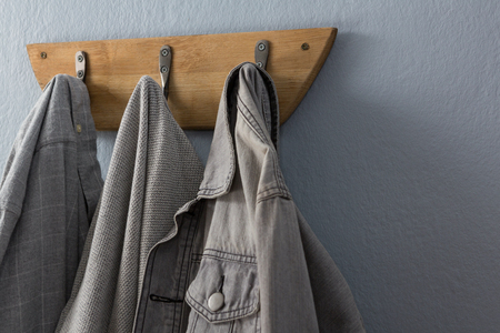 Close-up of denim jacket hanging on hook Stock Photo