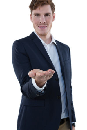 Businessman pretending to hold an invisible object against white background Stock Photo