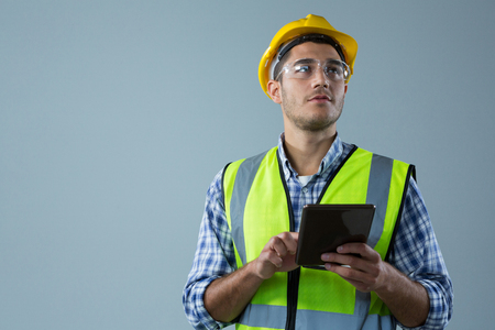 Male architect using digital tablet against white background Lizenzfreie Bilder