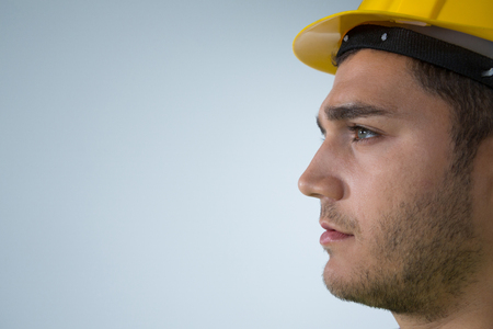 Close-up of confident male architect looking at side