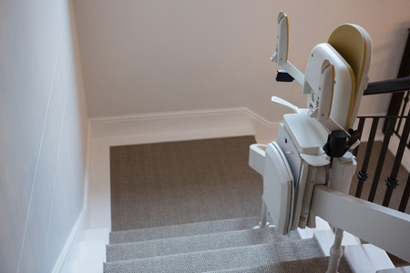 Close-up of stairlift on railing Stock Photo - 89773103