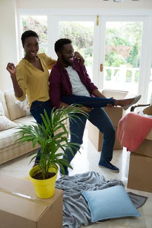 Happy couple enjoying in their new house Stock Photo