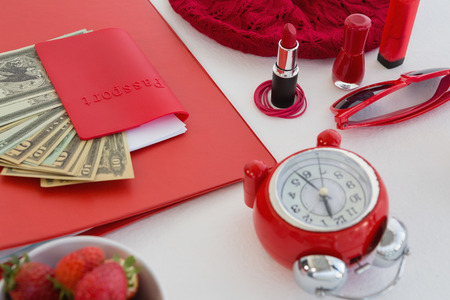 Close-up of female accessories, fruits and currency on white background