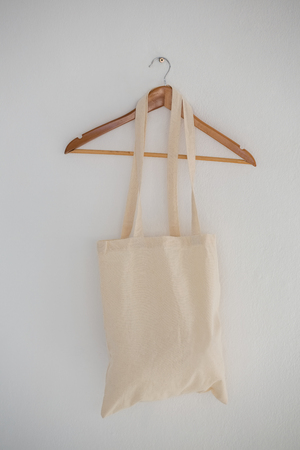 Close-up of grocery bag hanging on wall with hanger