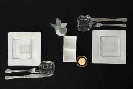 Overhead view of black theme table setting