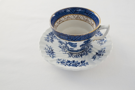 Close-up of empty cup with saucer