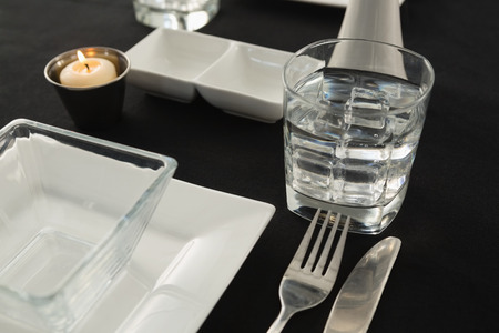 Close-up of black theme table setting