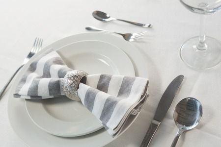 Close-up of plate and cutlery set on a table photo & Close-up Of Plate And Cutlery Set On A Table Stock Photo Picture ...