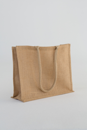 Close-up of jute bag on white background