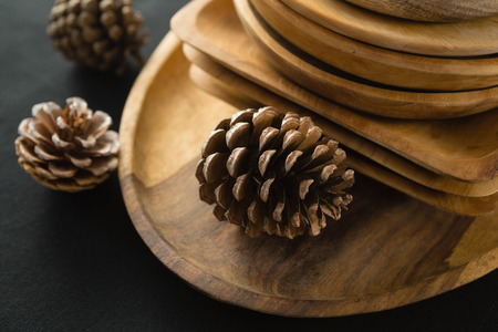 Close-up of wooden plates set on a black theme table Stock Photo