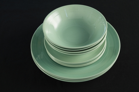 Close Up Of Dining Plates Set On Black Theme Table Stock Photo   90143867