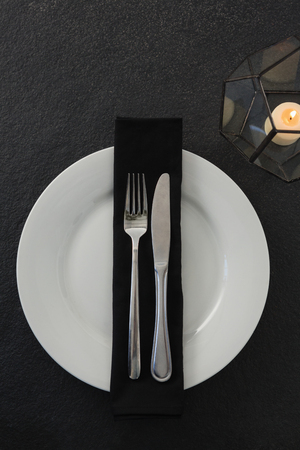 Close-up of table setting with lit candle Banque d'images