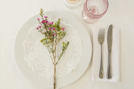 Overhead of plate and cutlery set elegantly on a table
