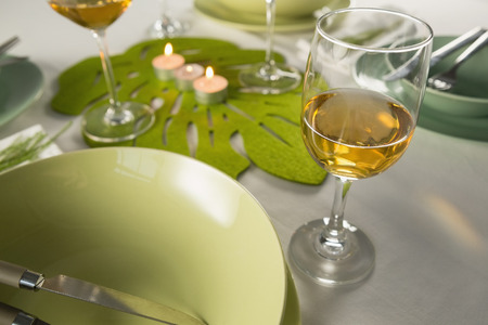 Close-up of wine glasses with table setting Stock Photo