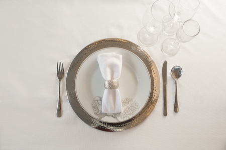 Overhead of elegance table setting on white background
