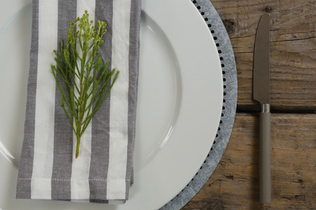 Close-up of table setting on weathered wooden plank Stock Photo