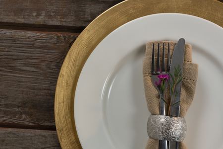 napkin ring: Close-up of elegance table setting on wooden plank