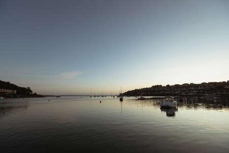 Fishing boat in sea at dusk LANG_EVOIMAGES