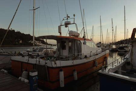 Moored boat at harbor during dusk
