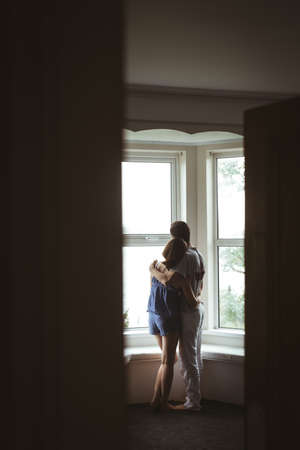 Romantic couple embracing each other at home
