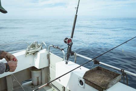 Fisherman preparing bait for fishing