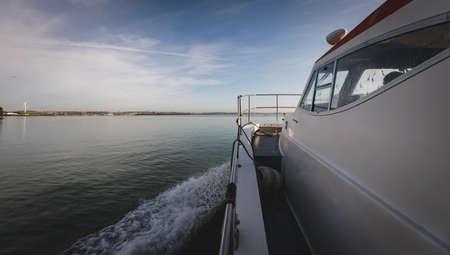 Fishing boat sailing in sea during morning