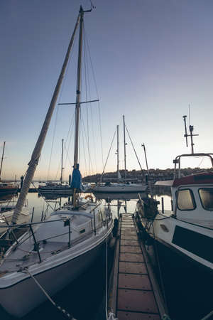 Boats moored at the harbour at sunset LANG_EVOIMAGES
