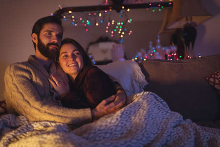 Happy couple relaxing on bed in bedroom a home