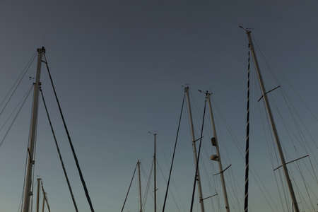 Pole of fishing boat against sky at dusk