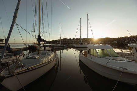 Moored boat at harbor during sunset