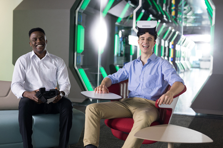 Portrait of male executives using virtual reality headset in office Stock Photo