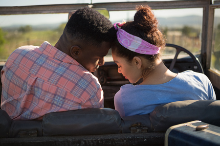 Couple romancing in a car at countryside Stock Photo