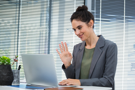 Female executive doing video call on laptop in office Stock Photo