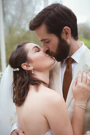 Close-up of bride and groom kissing each other