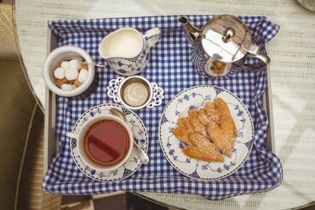 Overhead view of tray with tea and cookies LANG_EVOIMAGES
